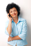 On The Phone. Happy senior woman using a cellphone over white background Stock Photography