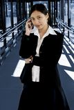 On the Phone. Businesswoman with her mobile phone Royalty Free Stock Photography
