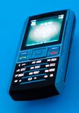 Phone 2. Fashionable mobile phone on a blue background Stock Image
