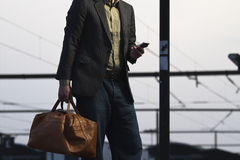 On the phone. Man on train station looking at phone Stock Photo