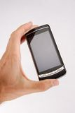 Phone 4. Glossy black cell phone in a man's hand Royalty Free Stock Image