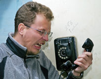 Phone. The man is angry on phone Stock Image