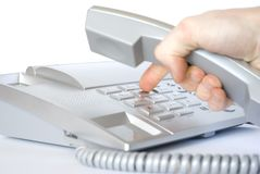Phone. Finger presses figure on phone Stock Photos