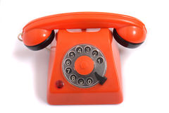 Phone. Old orange phone on the white background Stock Image