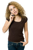 On the phone. A beautiful young women making a phone call Royalty Free Stock Image