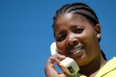 At the phone. South african xhosa woman with telephone Royalty Free Stock Photography