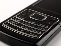 Phone. A macro of a black slim phone royalty free stock photo