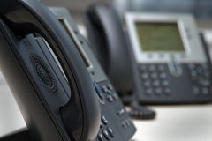 Phone. Office phones in the workplace Stock Images