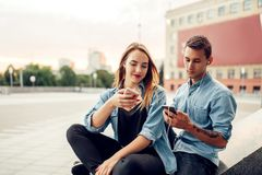 Phone addict couple cannot live without gadgets stock image
