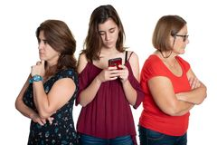 Phone addicted teenage girl with her worried mother and grandmother stock photo