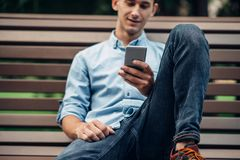 Phone addiction, addict man using smartphone royalty free stock photography