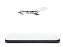 Phone and airplane model on white Royalty Free Stock Photos