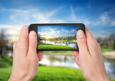 Phone And Spring Landscape Stock Images