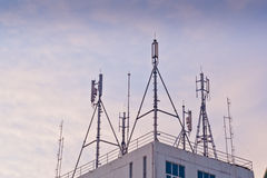 Phone antenna. Mounted atop a building Stock Photo