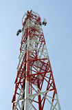 Phone antenna on a tall tower. Stock Photography