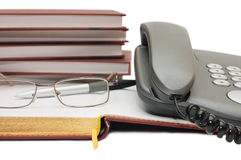 Phone, apple and glasses on the book Stock Photo