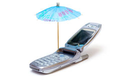 Phone as chaise longue and umbrella Stock Photography