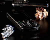 Phone as garbage Royalty Free Stock Images