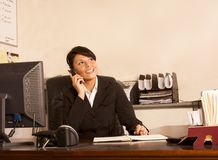 Phone assistant administrator woman in office Stock Photography