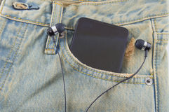 Phone in a back pocket of a denim jeans as a background. Pocket  jeans  background Phone  back Royalty Free Stock Photos