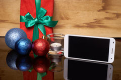 Phone on the background of the Christmas table Stock Photography