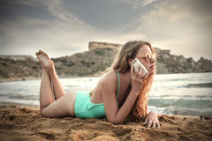 On the phone at the beach Royalty Free Stock Photos