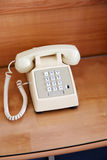 Phone on the bedside table Royalty Free Stock Photography