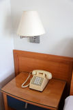 Phone on the bedside table Stock Photo