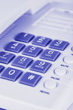 Phone in blue Royalty Free Stock Photos