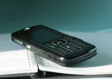 Phone on book Stock Photography
