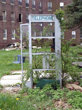 Phone Booth. Old and abandoned telephone booth stock image