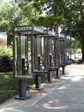 Phone booth. A row of identical pay phone booths Stock Photography