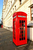 Phone booth. Famous red telephone booth in the street in London Royalty Free Stock Image