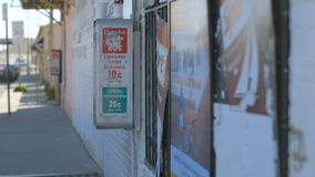 Phone Booth in a Border Town. With cars passing by in the distance stock footage