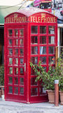 Phone Booth. British style red phone booth in the streets of Izmir, Turkey Stock Photo