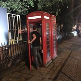 Phone booth call Royalty Free Stock Images
