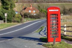 Phone booth in countryside Royalty Free Stock Photography