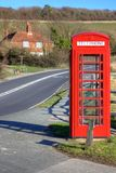 Phone booth in countryside Royalty Free Stock Images