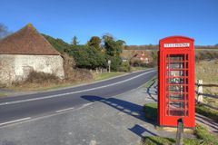 Phone booth in countryside Royalty Free Stock Photo