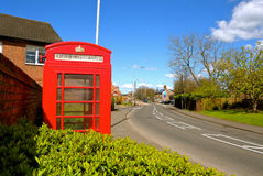 Phone booth in an English village Royalty Free Stock Images