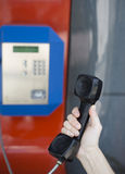 At the phone booth Stock Images