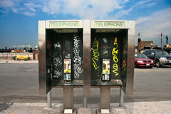 Phone booth with grafitti Royalty Free Stock Photos