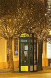 Phone booth at night with lots of light bulbs Royalty Free Stock Images