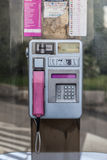 Phone Booth. An old phone booth in croatia, with aluminium dial and pink receiver Stock Photo