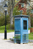 Phone booth and old lantern Royalty Free Stock Photo