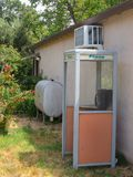Backyard phone booth. Phone booth, unusual backyard artifact Royalty Free Stock Photography