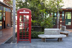 Phone booth and wooden chair Stock Photo