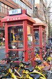 Phone booths locate in Shanghai, China. SHANGHAI, CHINA- JAN 08, 2018: Phone booths locate in Shanghai, China. As cell phone getting more popular phone booth is Stock Photography