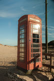 Phone box on the beach! Royalty Free Stock Images