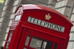 Phone box. Close up of red phone box, angle view Royalty Free Stock Photos